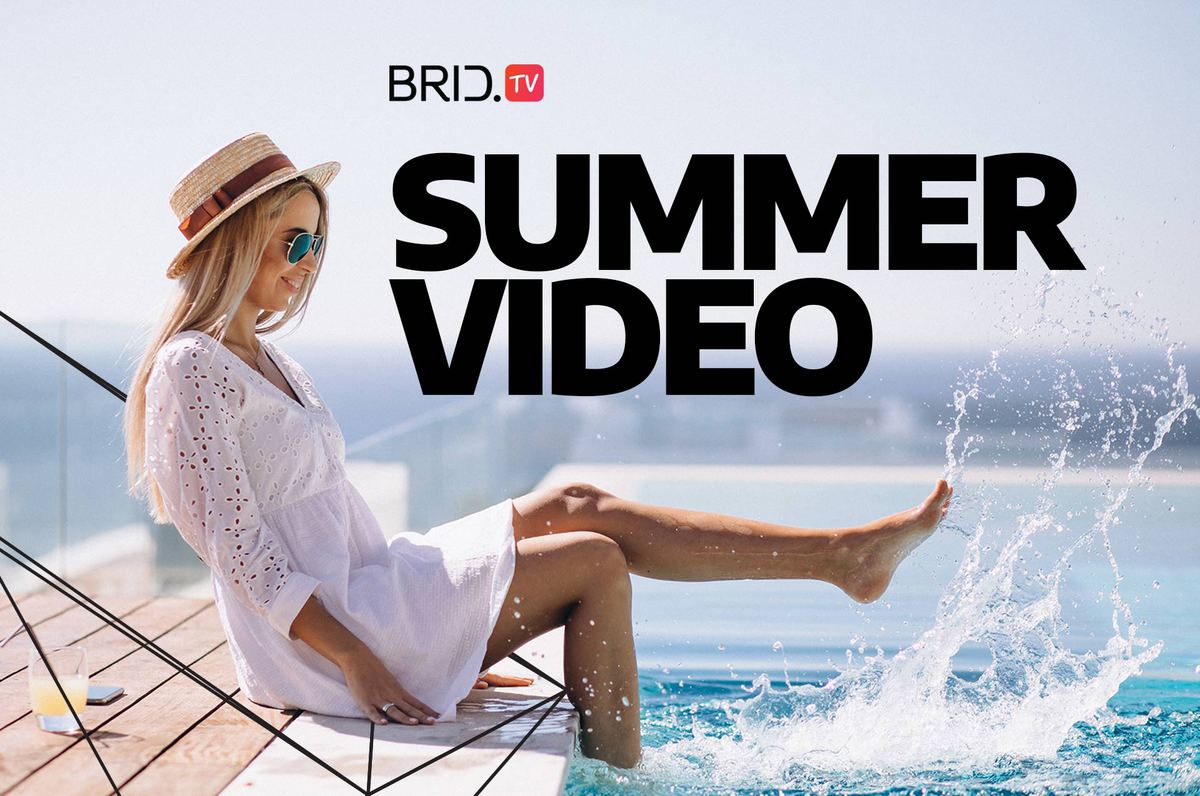 woman sitting in a chair and splashing her feet in the sea with summer video written above her